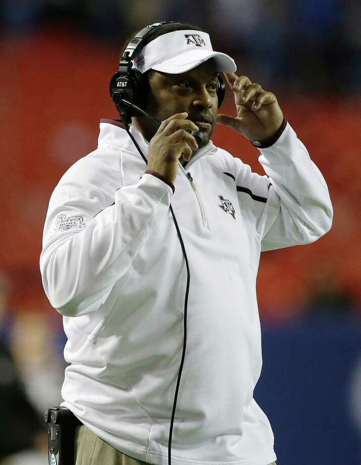 Texas A&M head coach Kevin Sumlin walks the sidelines in the first half of the Chick-fil-A Bowl NCAA college football game against Duke Tuesday, Dec. 31, 2013, in Atlanta. (AP Photo/John Bazemore) Photo: John Bazemore, Associated Press / AP