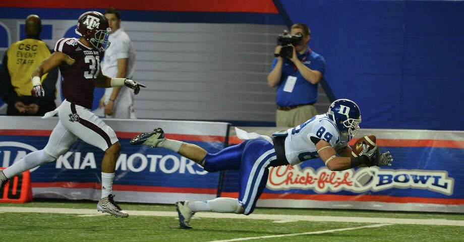 Duke Blue Devils tight end Braxton Deaver (89) dives for a first down against Texas A&M Aggies defensive back Howard Matthews (31) during the first quarter of the Chick-fil-A Bowl at the Georgia Dome in Atlanta on Tuesday, Dec. 31, 2013. (Chuck Liddy/Raleigh News & Observer/MCT) Photo: Chuck Liddy, McClatchy-Tribune News Service / Raleigh News & Observer