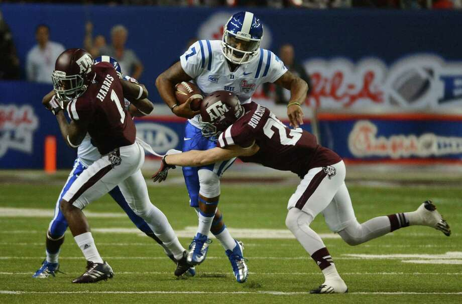 Duke Blue Devils quarterback Anthony Boone (7) is brought down by Texas A&M Aggies defensive back Clay Honeycutt (25) after making a first down during first-quarter action in the Chick-fil-A Bowl at the Georgia Dome in Atlanta on Tuesday, Dec. 31, 2013. (Chuck Liddy/Raleigh News & Observer/MCT) Photo: Chuck Liddy, McClatchy-Tribune News Service / Raleigh News & Observer