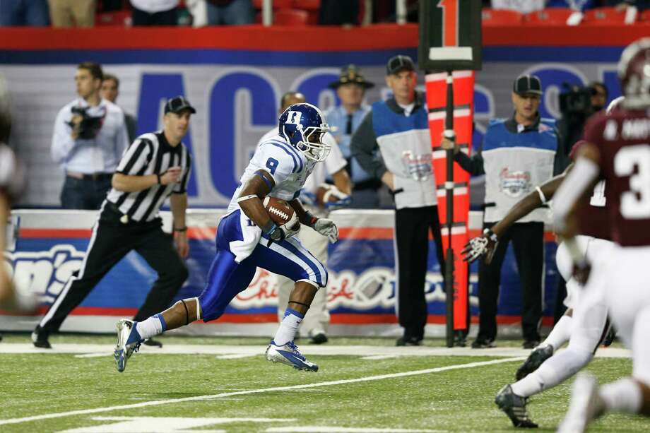ATLANTA, GA - DECEMBER 31: Josh Snead #9 of the Duke Blue Devils runs for an 11-yard touchdown after a reception in the first quarter against the Texas A&M Aggies during the Chick-fil-A Bowl at the Georgia Dome on December 31, 2013 in Atlanta, Georgia. Photo: Joe Robbins, Getty Images / 2013 Getty Images