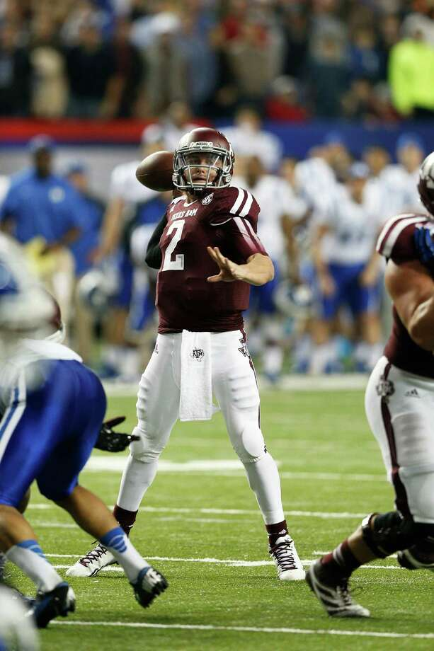 ATLANTA, GA - DECEMBER 31: Johnny Manziel #2 of the Texas A&M Aggies throws a nine-yard touchdown pass to Travis Labhart on fourth down in the second quarter against the Duke Blue Devils during the Chick-fil-A Bowl at the Georgia Dome on December 31, 2013 in Atlanta, Georgia. Photo: Joe Robbins, Getty Images / 2013 Getty Images