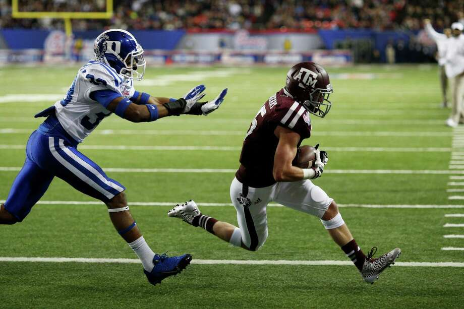 ATLANTA, GA - DECEMBER 31: Travis Labhart #15 of the Texas A&M Aggies makes a nine-yard touchdown reception on fourth down in the second quarter against the Duke Blue Devils during the Chick-fil-A Bowl at the Georgia Dome on December 31, 2013 in Atlanta, Georgia. Photo: Joe Robbins, Getty Images / 2013 Getty Images