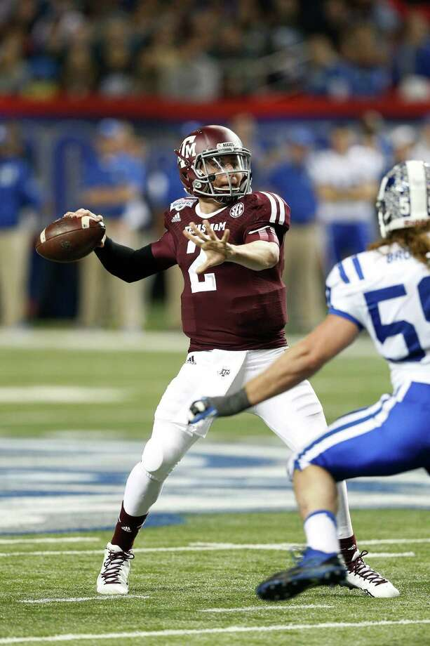 ATLANTA, GA - DECEMBER 31: Johnny Manziel #2 of the Texas A&M Aggies throws a pass in the first half against the Duke Blue Devils during the Chick-fil-A Bowl at the Georgia Dome on December 31, 2013 in Atlanta, Georgia. Photo: Joe Robbins, Getty Images / 2013 Getty Images