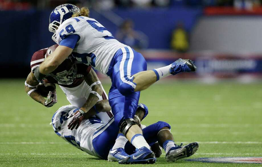 Texas A&M wide receiver LaQuvionte Gonzalez (6) is stopped by Duke linebacker Kelby Brown (59) in the first half of the Chick-fil-A Bowl NCAA college football game Tuesday, Dec. 31, 2013, in Atlanta. (AP Photo/John Bazemore) Photo: John Bazemore, Associated Press / AP