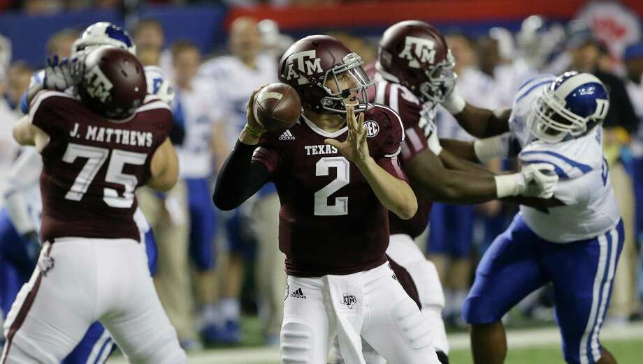 Texas A&M quarterback Johnny Manziel (2) looks for a receiver in the first half of the Chick-fil-A Bowl NCAA college football game against Duke Tuesday, Dec. 31, 2013, in Atlanta. (AP Photo/John Bazemore) Photo: John Bazemore, Associated Press / AP