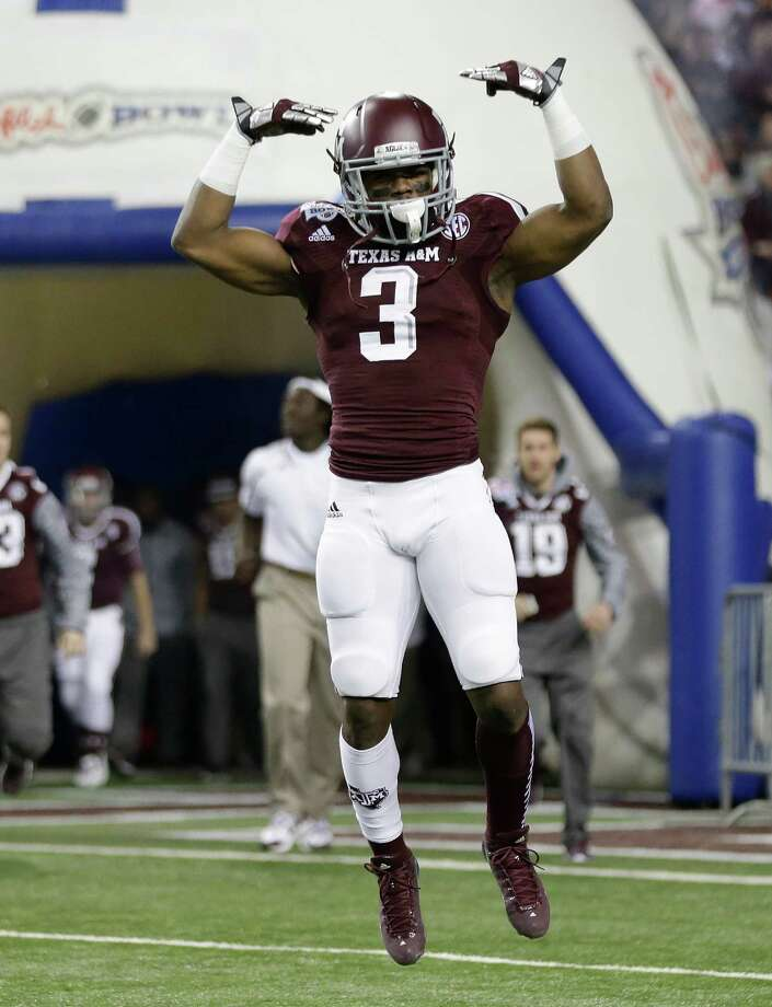 Texas A&M running back Trey Williams (3) reacts as he runs on the field in the first half of the Chick-fil-A Bowl NCAA college football game against Duke Tuesday, Dec. 31, 2013, in Atlanta. (AP Photo/John Bazemore) Photo: John Bazemore, Associated Press / AP