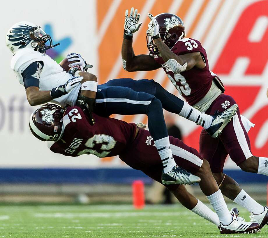 The finale of Rice's conference-title season proves to be a letdown for receiver Dennis Parks and the Owls. Photo: Smiley N. Pool, Staff / © 2013  Houston Chronicle
