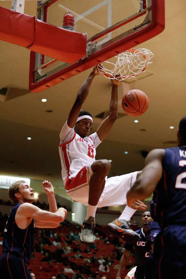 Houston guard Danrad Knowles rattles the rim en route to two of his 13 points in the Cougars' upset of No. 17 Connecticut on Tuesday night. Photo: Eric Kayne / Eric Kayne