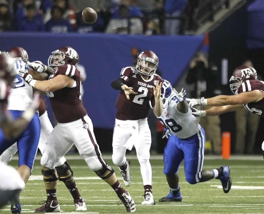 Texas A&M 52, Duke 48 Dec. 31, 2013  Johnny Manziel did what he does best in what could be his last game for the Aggies. Duke had a 38-17 lead at halftime, but Texas A&M saved the drama for the second half. Manziel led his team to a win at the Chick-fil-A bowl with a stellar performance. He completed 30 of 38 passes for 382 yards and four passing touchdowns. He also added a score on the ground with 73 rushing yards. Photo: Brett Coomer, Houston Chronicle