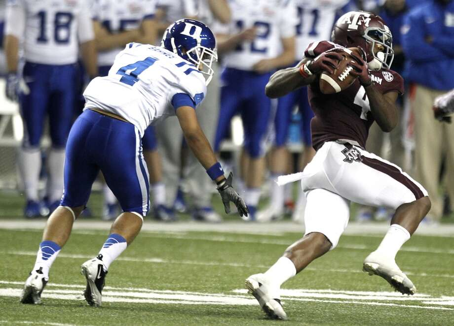 Texas A&M 52, Duke 48Record: 9-4Texas A&M defensive back Toney Hurd Jr. (4) jumps in front of Duke wide receiver Johnell Barnes, left, to intercept an Anthony Boone pass, which he returned 55 yards for a touchdown, during the fourth quarter. Photo: Brett Coomer, Houston Chronicle