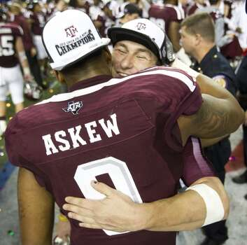 Texas A&M quarterback Johnny Manziel and linebacker Nate Askew embrace after the Aggies defeated Duke in the Chick-fil-A bowl. Photo: Brett Coomer, Houston Chronicle