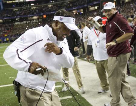 Texas A&M coach Kevin Sumlin gets the obligatory sports drink bath after his team beat Duke in the Chick-fil-A Bowl. Photo: Brett Coomer, Houston Chronicle