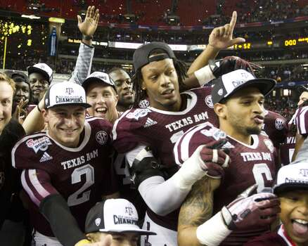 Aggies celebrate their win against Duke in the Chick-fil-A Bowl. Photo: Brett Coomer, Houston Chronicle