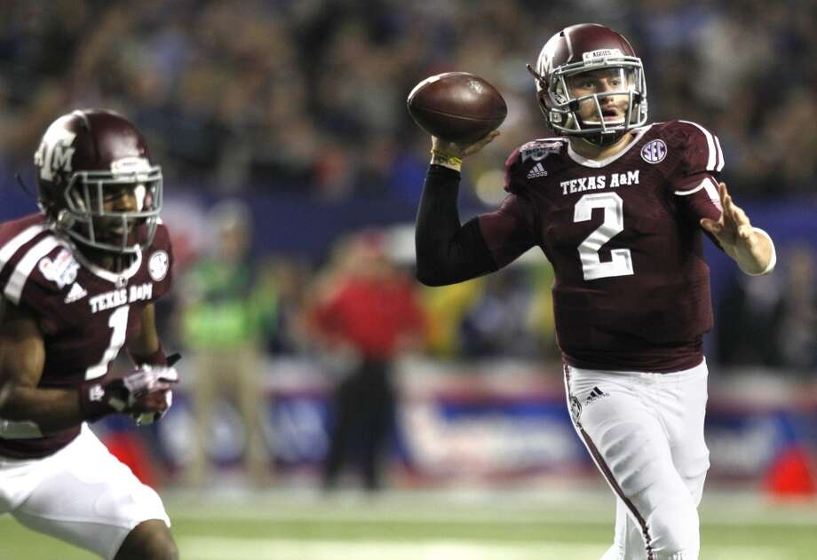 Texas A&M quarterback Johnny Manziel attempts a throw versus Duke. Photo: Brett Coomer, Houston Chronicle