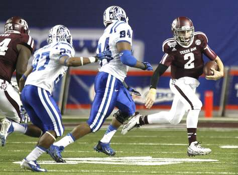 Texas A&M quarterback Johnny Manziel scrambles against Duke. Photo: Brett Coomer, Houston Chronicle