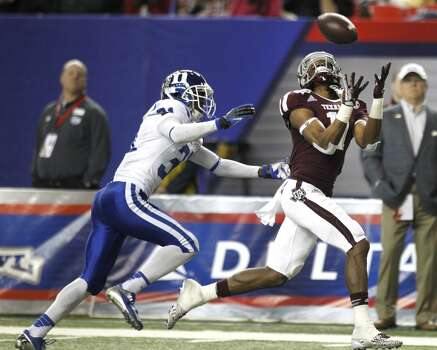Texas A&M receiver Derel Walker catches a 44-yard touchdown reception against duke. Photo: Brett Coomer, Houston Chronicle