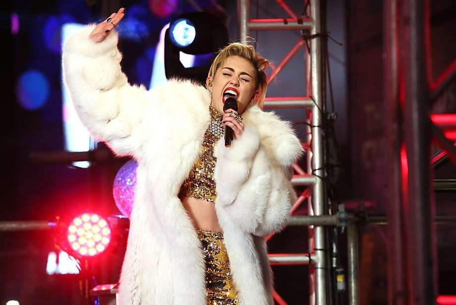 Miley Cyrus performs on stage ahead of midnight at The New Year's Eve 2014 Celebration in Times Square on December 31, 2013 in New York City. Photo: Neilson Barnard, Getty Images