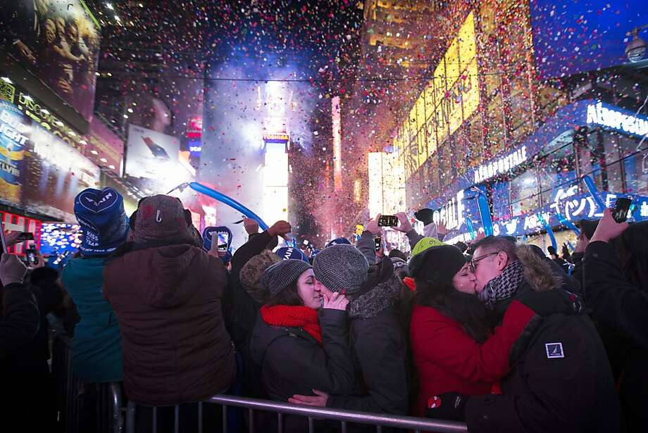 Miranda Echerarria and Christian Prieto, of Niagra, N.Y. kiss at the stoke of midnight during the New Year's Eve celebrations in Times Square, Wednesday, Jan. 1, 2014, in New York. Photo: John Minchillo, Associated Press