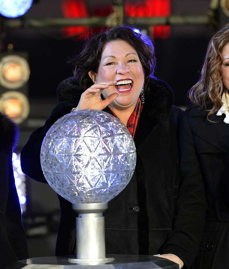 Supreme Court Justice Sonia Maria Sotomayor presses the countdown ball as thousands of revelers gather in New York's Times Square to celebrate the ball drop at the annual New Years Eve celebration on December 31, 2013  in New York City. Photo: Timothy A. Clary, AFP/Getty Images