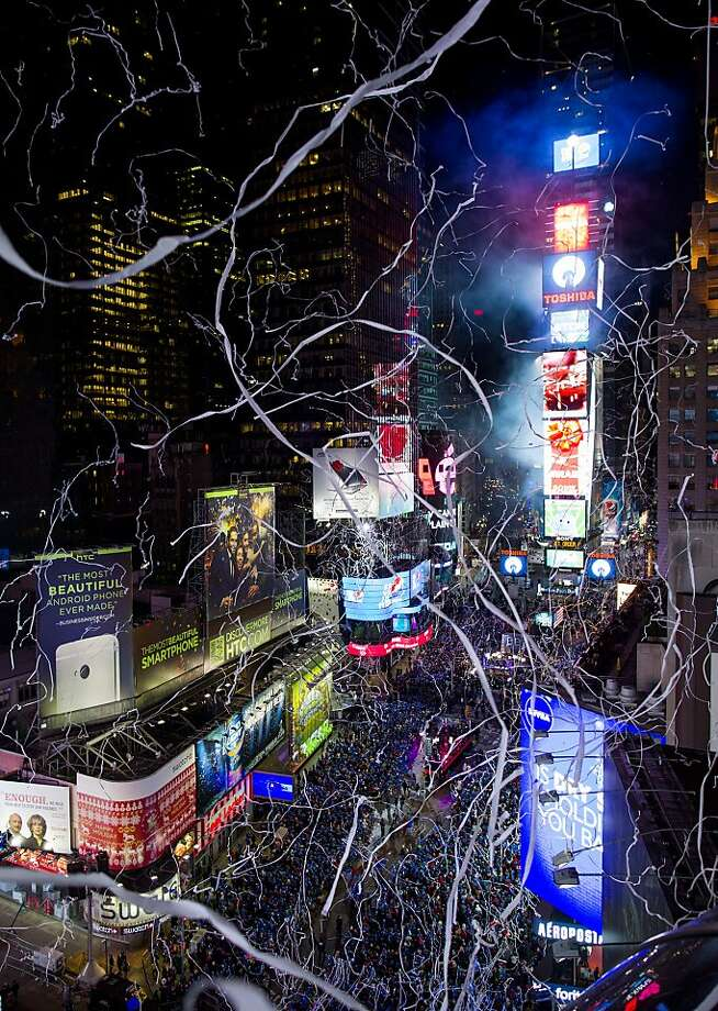 Confetti flies over Times Square two hours before midnight, during New Year's Eve celebrations in New York Thursday, Dec. 31, 2013.  Photo: Craig Ruttle, Associated Press