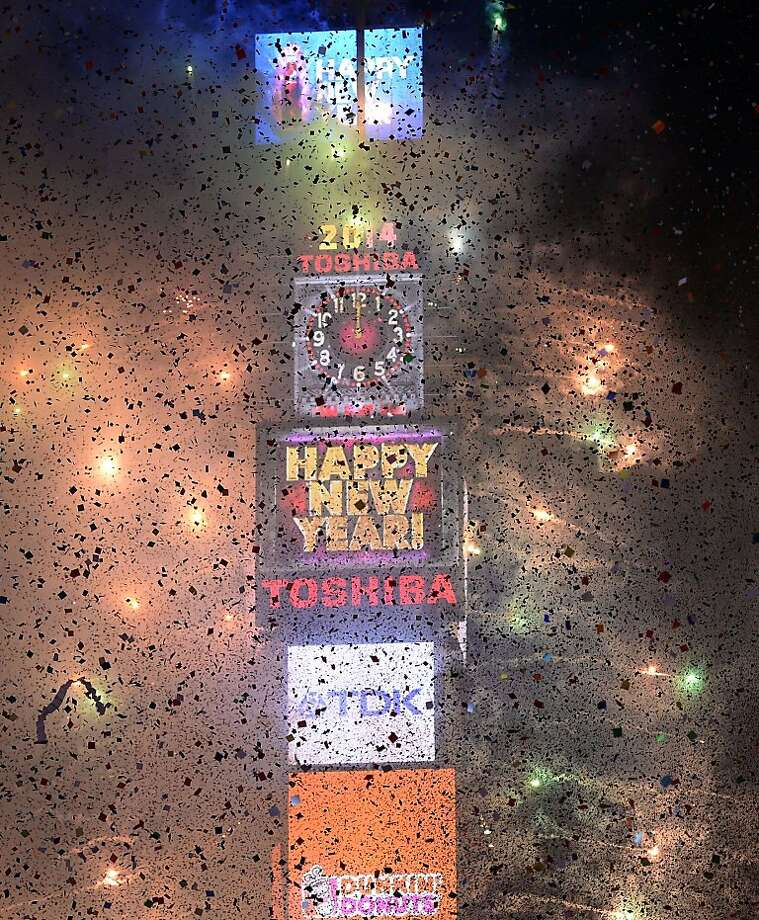 Fireworks light up Times Square as the Countdown Ball  drops as thousands of revelers gather in New York's Times Square to celebrate the ball drop at the annual New Years Eve celebration on December 31, 2013  in New York City. Photo: Timothy A. Clary, AFP/Getty Images