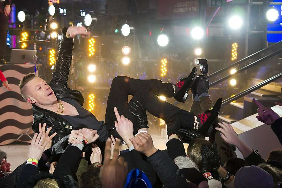 Macklemore performs in Times Square during New Year's Eve celebrations on Tuesday, Dec. 31, 2013 in New York. Photo: Charles Sykes, Associated Press