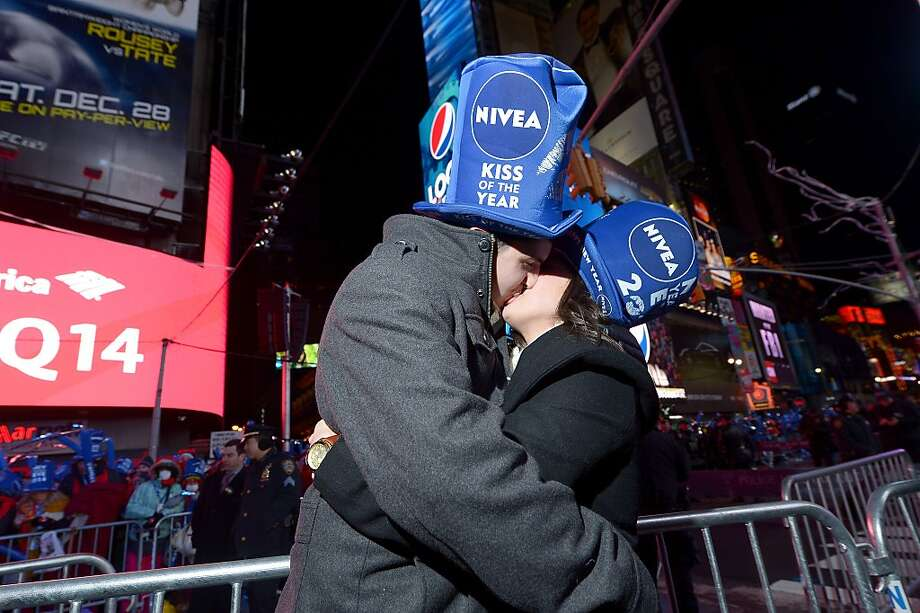 Zac Hihey surprises his girlfriend, Hannah Kanaan, with a proposal on the NIVEA Kiss Stage in Times Square on December 31, 2013 in New York City. Photo: Michael Loccisano, Getty Images For Nivea