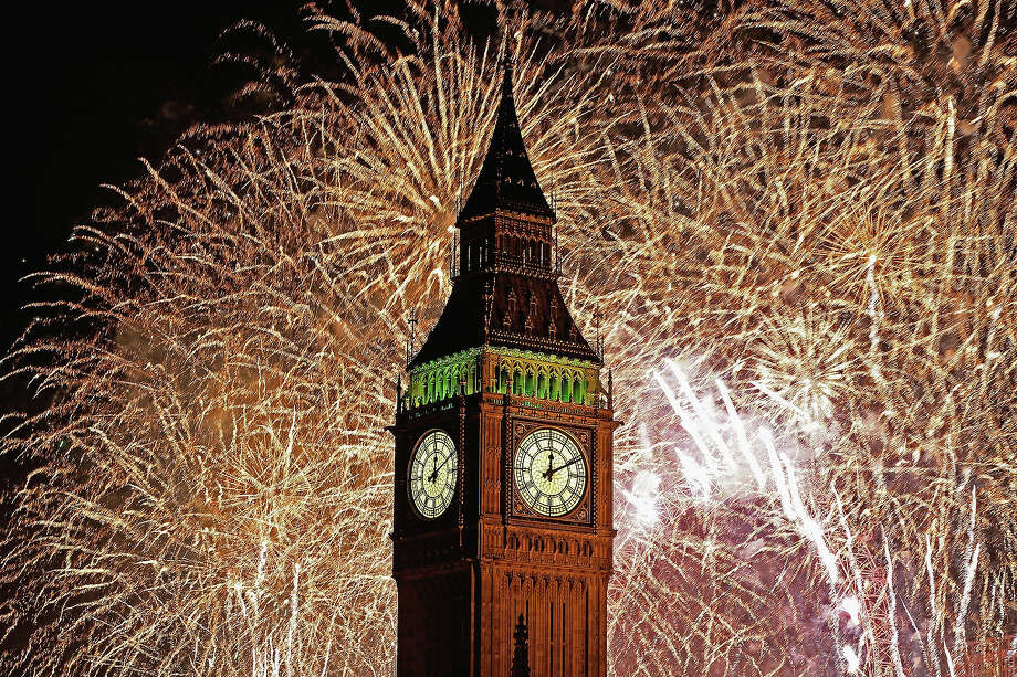 Fireworks light up the London skyline and Big Ben just after midnight on January 1, 2014 in London, England. Thousands of people lined the banks of the River Thames in central London to see in the New Year with a spectacular fireworks display. Photo: Dan Kitwood, Getty Images / 2014 Getty Images