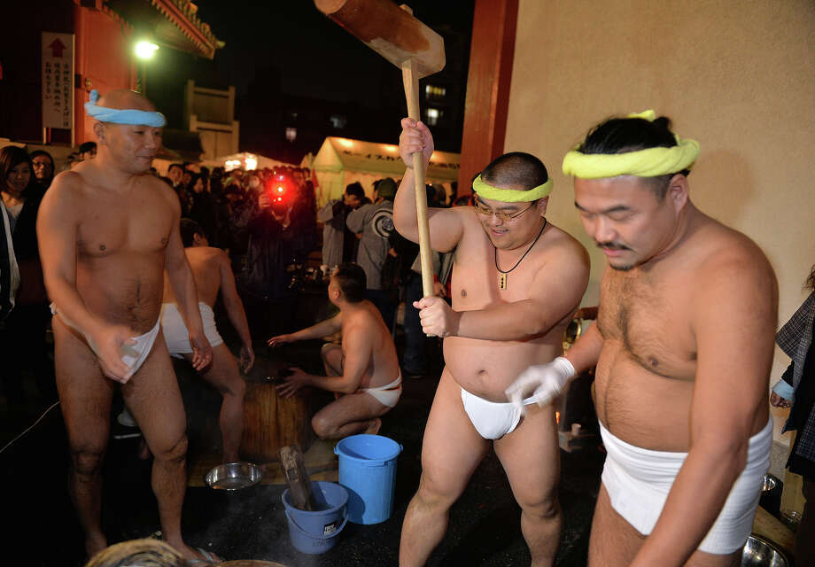 Naked men in loinclothes pound steamed rice into a mochi, rice cake to celebrate the New Year at the Kanda shrine in Tokyo on January 1, 2014. Million of Japanese people visit shrines and temples to pray for the well-being of their families at the New Year. Photo: YOSHIKAZU TSUNO, AFP/Getty Images / 2013 AFP