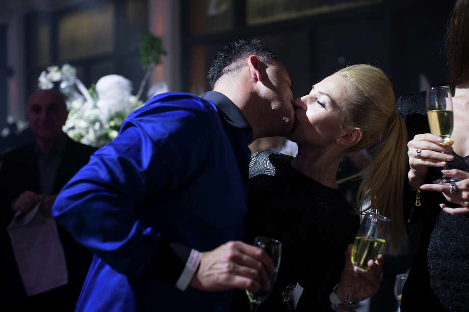 A couple kissing during a party as Israeli's of Russian descent celebrate the New Year on January 01, 2013 in Tel Aviv, Israel. More the 100,000 immigrants from the former Soviet Union live in Israel, most of them arriving to the country in the 90's. Photo: Uriel Sinai, Getty Images / 2013 Getty Images