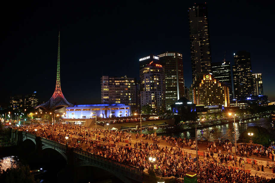 Huge crowds gather on Princes Bridge during New Years Eve fireworks on December 31, 2013 in Melbourne, Australia. Photo: Vince Caligiuri, Getty Images / 2013 Getty Images