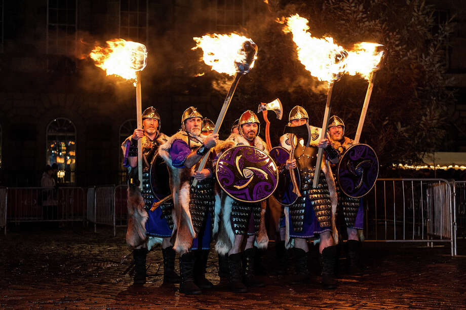 Men dressed as vikings take part at a photocall before participating in the Torchlight Procession during Edinburgh's Hogmanay on December 30, 2013 in Edinburgh, Scotland. Photo: Roberto Ricciuti, Redferns Via Getty Images / 2013 Roberto Ricciuti