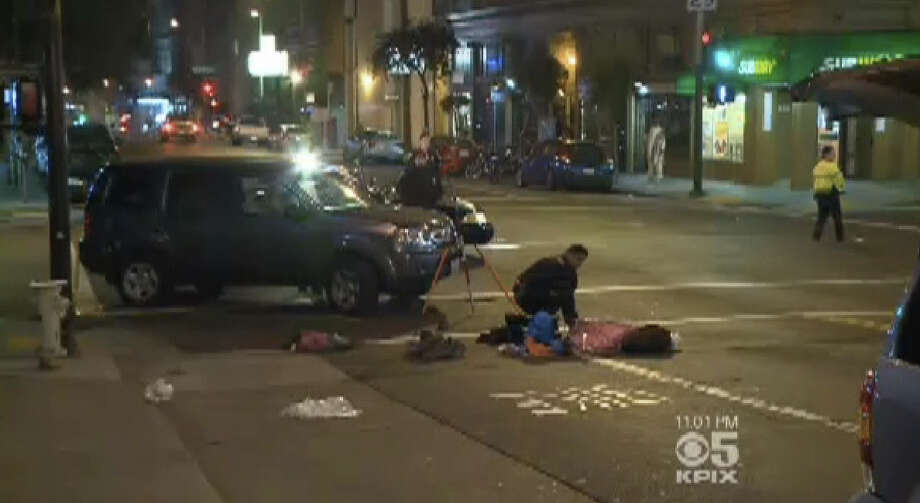 A child was killed and a woman and child injured tonight in San Francisco's Tenderloin neighborhood when a vehicle struck three pedestrians crossing the street. Photo: CBS San Francisco