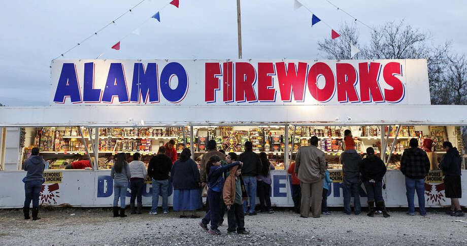 Stop the car! A fireworks stand!  A reader says the city's anti-fireworks ordinance is a farce and breeds contempt for an unpopular law. Photo: Express-News File Photo / © 2012 San Antonio Express-News