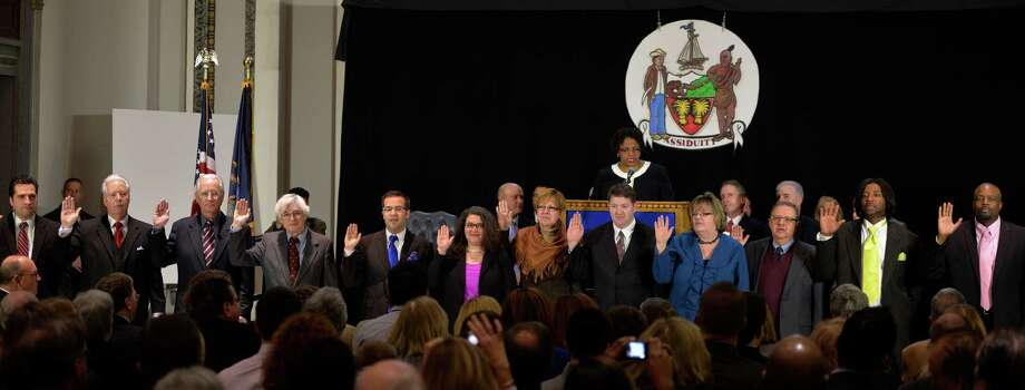 City Council President Carolyn McLaughlin, at the podium swears in the entire Albany City Council during the Inauguration ceremony of Mayor Kathy Sheehan Wednesday  Jan 1, 2014 at the Kiernan Plaza in Albany, N.Y. (Skip Dickstein / Times Union) Photo: SKIP DICKSTEIN / 0025149A