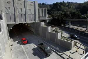 Westbound traffic emerges from the new fourth bore of the Caldecott Tunnel in Oakland, Calif., which opened for business on Saturday, Nov. 16, 2013. Adding a fourth tunnel is expected to alleviate choke points that are common in the non-commute direction on Highway 24.