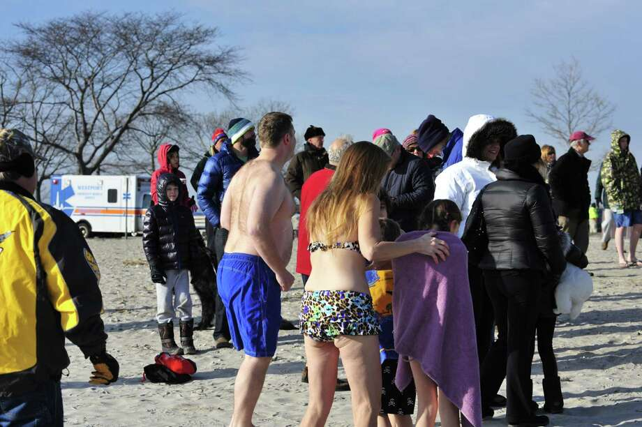 Team Mossman held their 11th annual polar plunge on New Year's Day at Compo Beach in Westport.  The plunge was scheduled for 10 a.m.  The air was brisk and we can only imagine what temperature the water was. All of the donations these divers collect benefit Save the Children.  Save the Children is a charity that helps improve the lives of impoverished children in more than 120 countries around the world.   Photo: Marc Poirier, Marc Poirier / Hearst Connecticut Media Group / Marc Poirier Photography
