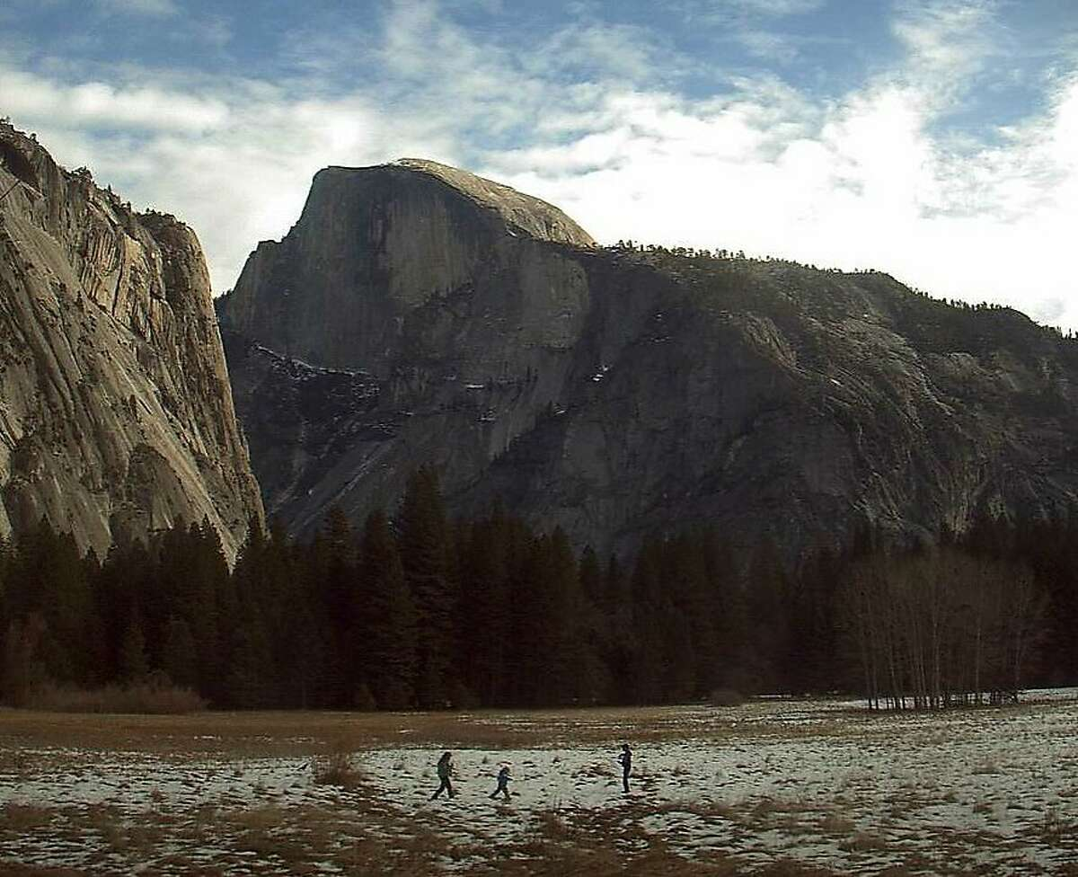 The scene this week in Yosemite Valley -- youngsters try to play in patchy snow in the meadows at the foot of Half Dome