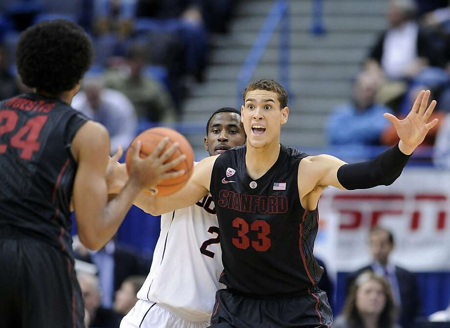 """Point forward"" Dwight Powell, a 6-foot-10 senior, leads Stanford with 4.2 assists per game. Photo: Fred Beckham, Associated Press"