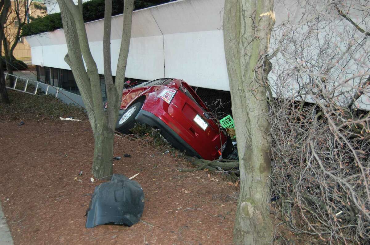 The driver of a 2008 Ford Edge needed to be extricated by Stamford Fire & Rescue firefighters Wednesday morning after he drove into a ditch next to 301 Tresser Blvd. The 49-year-old man suffered minor injuries and was charged with failure to drive in the proper lane.