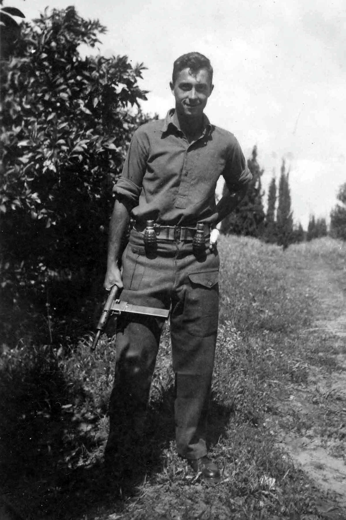 Ariel Sharon holds a Sten gun as a young commander in the Alexandroni Brigade of the fledging Israeli army during the War of Independence in 1948.