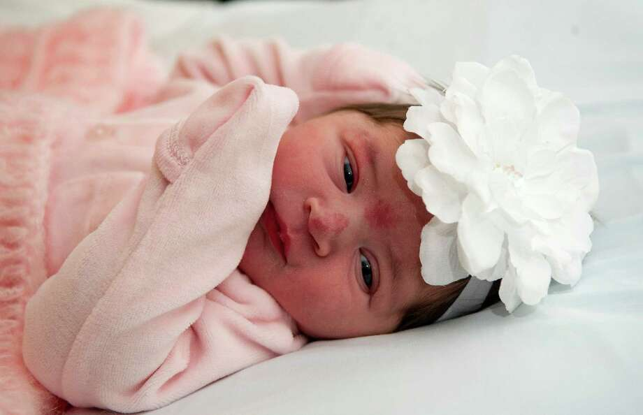 Gianna Renee Magnotta is pictured after she was born the first baby in Greenwich, Conn., in 2014. She weighed 8 pounds, 13 ounces, was 21.5 inches, and was born at 3:46 a.m. Photo: Lindsay Perry / Stamford Advocate