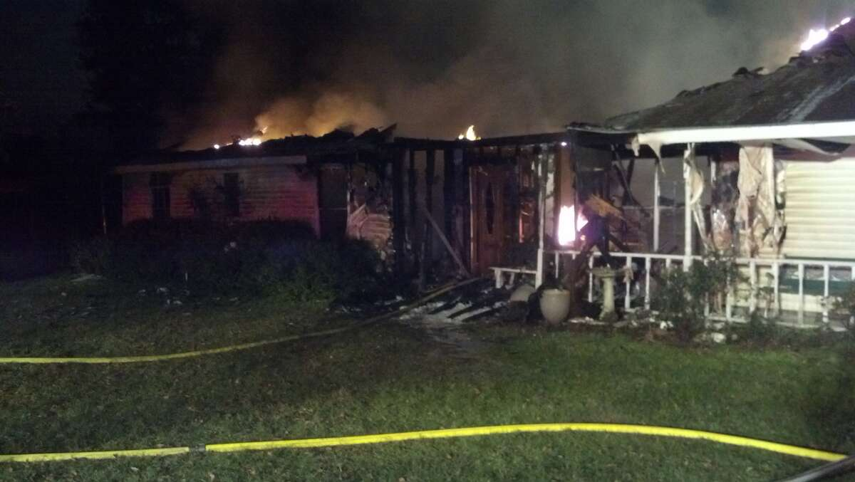A fire caused by fireworks destroyed the homes of three families in Cypress on New Year's Day.
