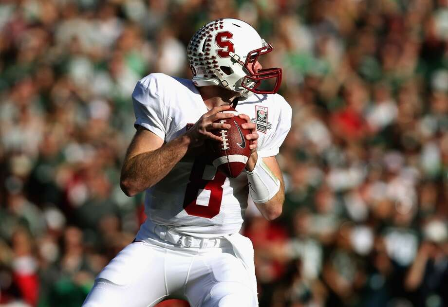 Quarterback Kevin Hogan of the Stanford Cardinal drops back to pass against the Michigan State Spartans in the first quarter. Photo: Jeff Gross, Getty Images