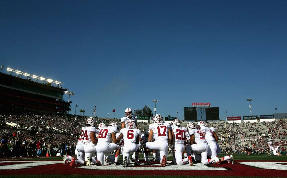 Members of the Stanford Cardinal football team kneel on the field prior to the 100th Rose Bowl Game presented by Vizio at the Rose Bowl on January 1, 2014 in Pasadena, California. Photo: Stephen Dunn, Getty Images