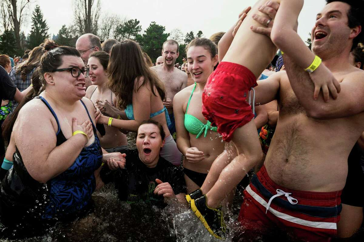 Hundreds of brave souls charged into the frigid waters of Pontiac Bay during the 12th Annual Polar Bear Plunge Wednesday, Jan. 1, 2014, at Matthews Beach Park in Seattle. About 300 people participated in the first Polar Bear Plunge in 2003; since then, attendance has nearly reached 1,000 attendees.