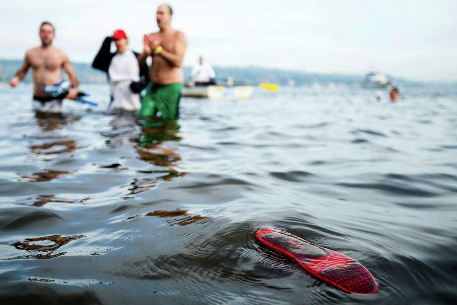 A lone shoe floats unattended following the 12th Annual Polar Bear Plunge Wednesday, Jan. 1, 2014, at Matthews Beach Park in Seattle. About 300 people participated in the first Polar Bear Plunge in 2003; since then, attendance has nearly reached 1,000 attendees. Photo: JORDAN STEAD, SEATTLEPI.COM / SEATTLEPI.COM