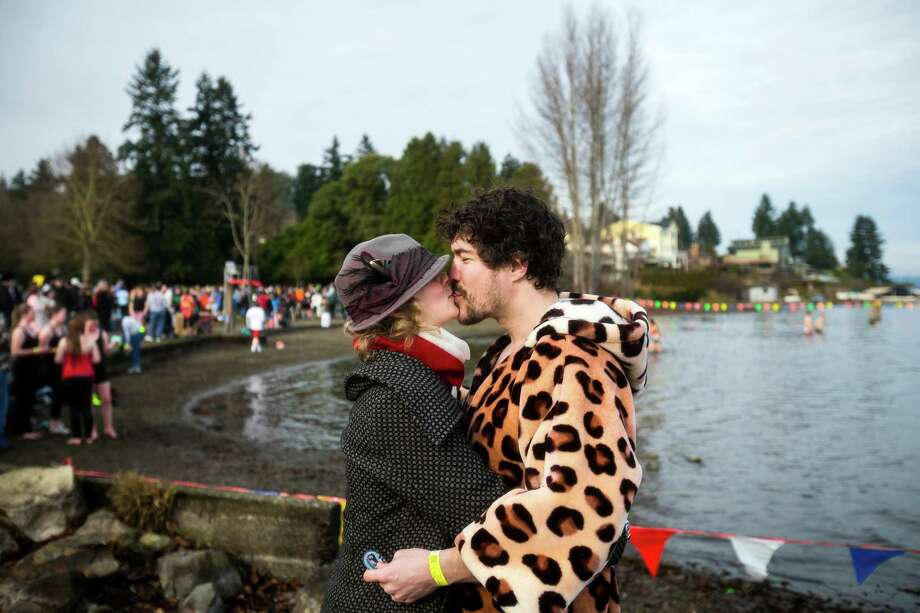 Decked out in a leopard robe, Maximilian Dixon, right, kisses Suenne Dixon, left, following during the 12th Annual Polar Bear Plunge Wednesday, Jan. 1, 2014, at Matthews Beach Park in Seattle. About 300 people participated in the first Polar Bear Plunge in 2003; since then, attendance has nearly reached 1,000 attendees. Photo: JORDAN STEAD, SEATTLEPI.COM / SEATTLEPI.COM