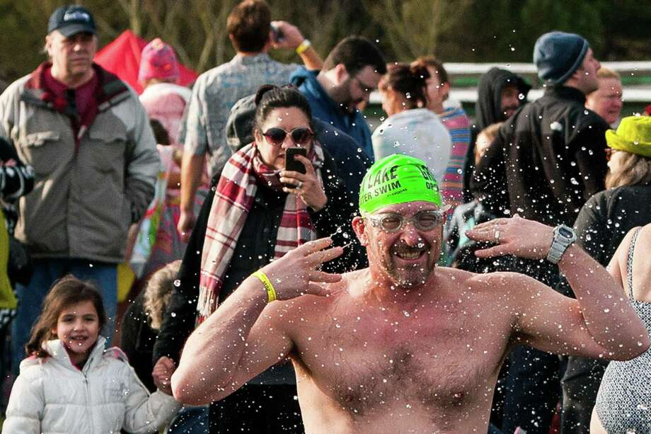 A man preps for the 12th Annual Polar Bear Plunge by throwing water on himself Wednesday, Jan. 1, 2014, at Matthews Beach Park in Seattle. About 300 people participated in the first Polar Bear Plunge in 2003; since then, attendance has nearly reached 1,000 attendees. Photo: JORDAN STEAD, SEATTLEPI.COM / SEATTLEPI.COM