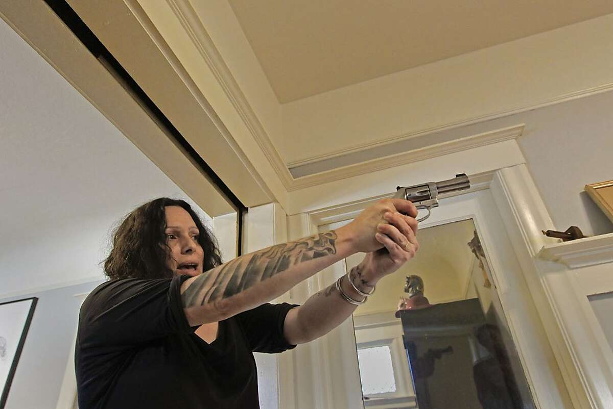 East Bay chapter of the Liberal Gun Owners Association, president Marlene Hoeber demonstrates proper use of a hand gun, at her Oakland, Ca. home, on Saturday Nov. 16, 2013. The East Bay Liberal Gun Club is made up of loyal gun owners who are NRA members -- and who buck the trend of NRA opposition to safety checks, wait periods and other laws to improve gun safety.